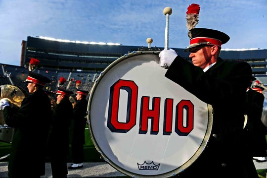 Members of Ohio State Buckeyes marching band on the field prior to the game against the Michigan Wolverines at Michigan Stadium.