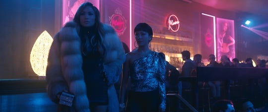 "Ramona (Jennifer Lopez, left) and Destiny (Constance Wu) are former strip-club employees who make ends meet in criminal fashion in ""Hustlers."""