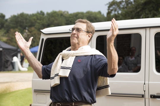 Preacher Eli Gemstone (John Goodman) gives thanks during an episode of the new HBO comedy, 'The Righteous Gemstones.'