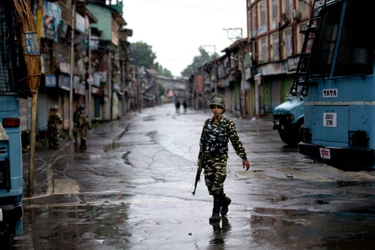 An Indian paramilitary soldier patrols during security lockdown in Srinagar, Indian controlled Kashmir, Wednesday, Aug. 14, 2019.