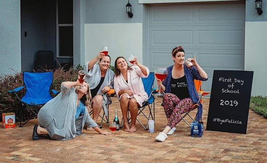 Florida moms send their 14 children back to school with an epic 'wine' and donut photo.