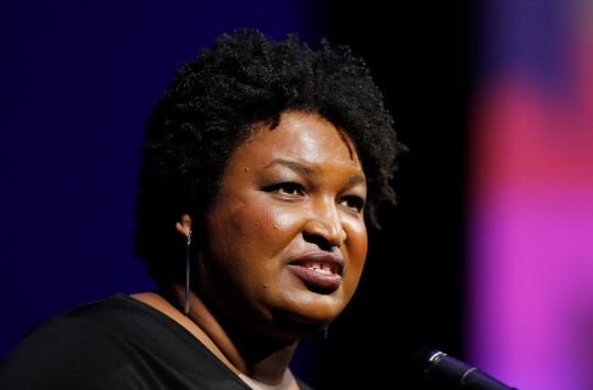 Former Georgia House Minority Leader Stacey Abrams addresses the 110th NAACP National Convention, Monday, July 22, 2019, in Detroit. (AP Photo/Carlos Osorio) ORG XMIT: otkco104