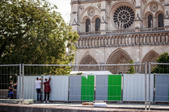 A perimeter is built around Notre Dame Cathedral ahead of the start of efforts to remove hundreds of tons of lead pollution left behind by the April fire that damaged the church.