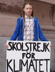 Greta Thunberg protesting outside the Swedish parliament.