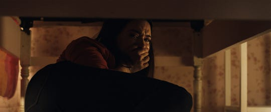 """Katie Stevens plays a young woman who faces the terror of an all-too-real haunted house on Halloween in """"Haunt."""""""