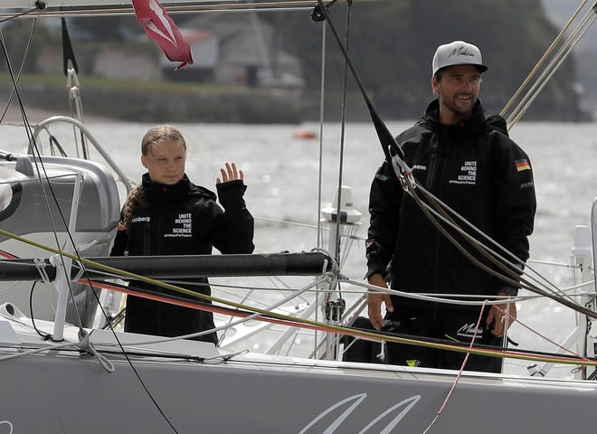 PLYMOUTH, ENGLAND: Climate change activist Greta Thunberg sets sail for New York in the 60ft Malizia II yacht from Mayflower Marina, on August 14, 2019 in Plymouth, England.