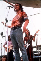 Musician Joe Cocker performs for the thousands of people attending the Woodstock Festival of Arts and Musik at Bethel, New York August 1969 (AP-Photo) (Via MerlinFTP Drop)