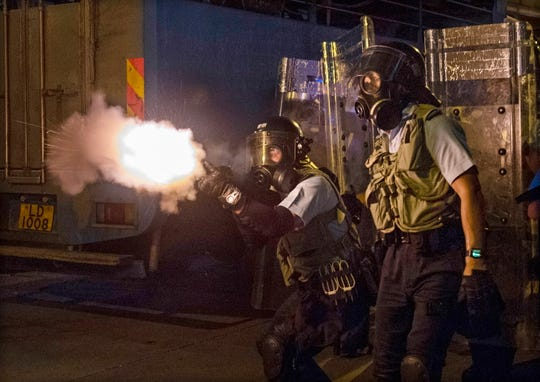 Police fire tear gas to disperse protesters attending an anti-government rally in Sham Shui Po, Hong Kong, China on August 14, 2019.