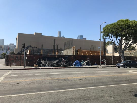 An apartment building for the homeless starts to take shape on Los Angeles' Skid Row -- with homeless people camping on the sidewalk in front of it.