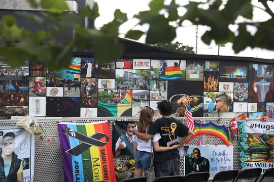 ORLANDO, FL - JUNE 12:  Jillienne Riethmiller (L) and Zachary Guadalupe spend time at the memorial set up for the shooting victims at Pulse nightclub where the shootings took place two years ago on June 12, 2018 in Orlando, Florida. On June 12, 2016 a mass shooting took place at Pulse nightclub killing 49 people and wounding 53 in one of the worst mass shootings in U.S. history.  (Photo by Joe Raedle/Getty Images) ORG XMIT: 775175730 ORIG FILE ID: 972400998