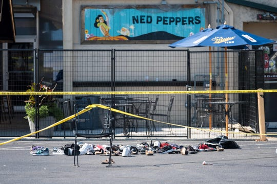 Pairs of shoes are piled behind the Ned Peppers bar belonging to victims of a shooting that took place in Dayton, Ohio, on Aug. 04, 2019.