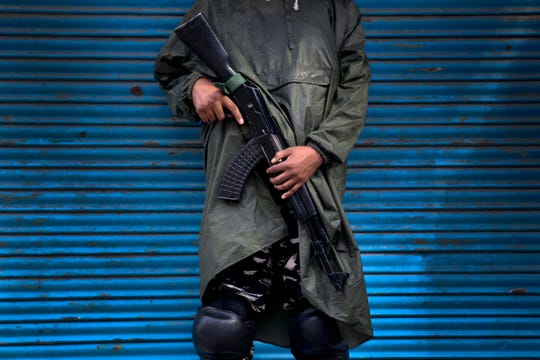 An Indian paramilitary soldier stands guard during security lockdown in Srinagar, Indian controlled Kashmir, Wednesday, Aug. 14, 2019.