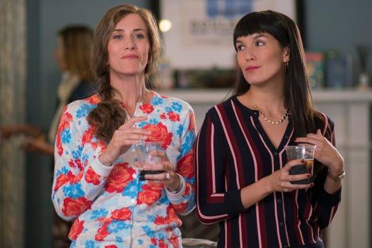 Audrey (Kristen Wiig, left) and Soo-Lin (Zoe Chao) are two judgmental moms at Bee's prestigious private middle school.