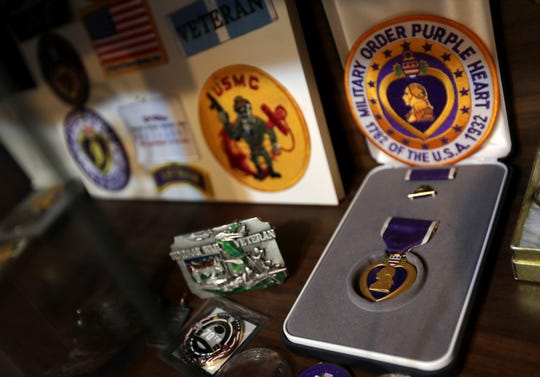 "LeRoy ""Lee"" Schuff's Purple Heart is displayed at his home Thursday in Neenah. Schuff went on the first Purple Heart Patriot Project mission to New York."