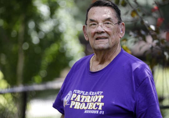 "LeRoy ""Lee"" Schuff, a participant on the first Purple Heart Patriot Project Mission to New York, poses outside of his home Thursday in Neenah."