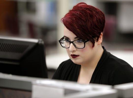 Molly Fannin searches for work on a computer at the Fox Cities Workforce Development Center in Menasha.