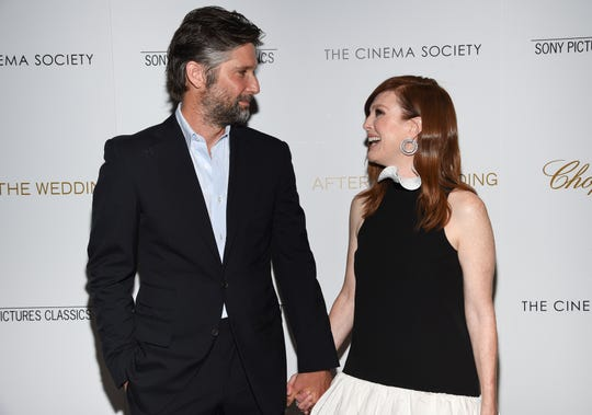 "Director Bart Freundlich, left, and wife, actor Julianne Moore, attend a special screening of ""After the Wedding,"" hosted by Chopard with Sony Pictures Classics and The Cinema Society, at the Regal Essex on Tuesday, Aug. 6, 2019, in New York. (Photo by Evan Agostini/Invision/AP)"