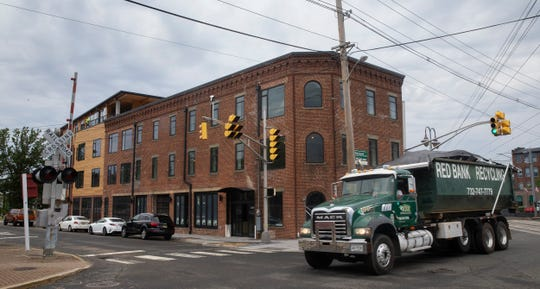 Metrovation is redeveloping the former Anderson Moving & Storage building on Monmouth Street in Red Bank into a 49,000-square-foot mixed use building. A Sickles wine shop and market will occupy the ground floor.