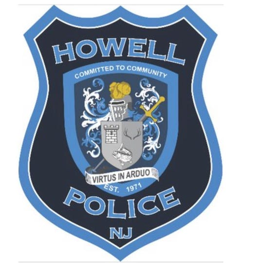 Howell Township Police Department emblem and shield.
