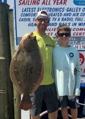 Easton Braun, left, of Kirkwood, Pennsylvania with a 10-pound, 3-ounce fluke he caught on the Norma K III.