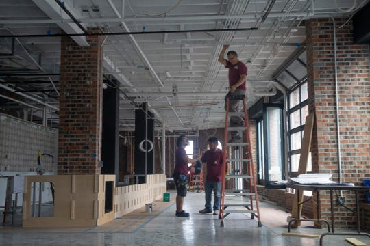 Workers go about the business of renovating. Metrovation is redeveloping the former Anderson Moving & Storage building on Monmouth Street in Red Bank into a 49,000-square-foot mixed use building. A Sickles wine shop and market will occupy the ground floor.