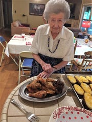 Ellen Webb with a platter of fried chicken that, family insists, would have Col. Sanders licking his fingers.
