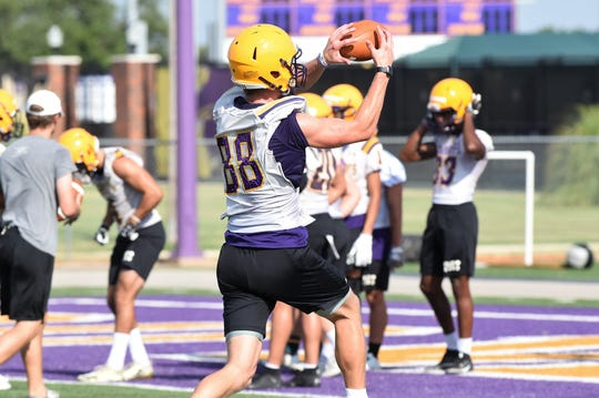 Hardin-Simmons receiver Jaxson Money (88) turns to catch a pass during the first fall practice at Shelton Stadium on Thursday, Aug. 15, 2019. The Cowboys open the season on Aug. 31 at Sul Ross State.