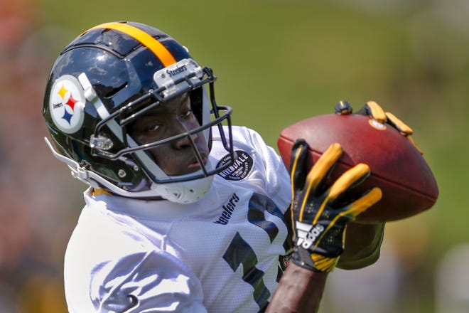 Pittsburgh Steelers wide receiver James Washington making a catch during an NFL football training camp practice in Latrobe, Pa., on July 27, 2019. Washington knows he didn't live up to expectations as a rookie last year. He found solace, and his confidence, working alongside his dad in the cotton fields back home in Texas, a bit of offseason work that provided Washington with needed perspective heading into 2019. (AP Photo/Keith Srakocic)