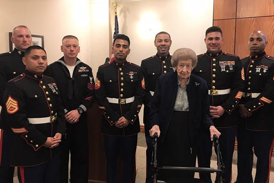 It may be a man's world in the Marines, but Ellen Webb made her mark and enjoyed her yearly meeting with boys when the USMC celebrates its birthday with a cake-cutting event.