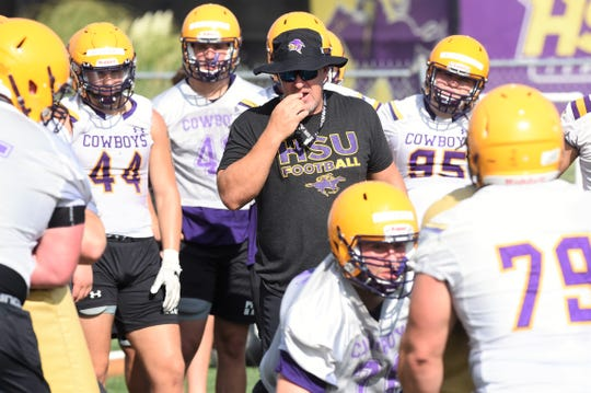 Hardin-Simmons head coach Jesse Burleson over looks an offensive line drill during the first fall practice at Shelton Stadium on Thursday, Aug. 15, 2019. The Cowboys open the season on Aug. 31 at Sul Ross State.