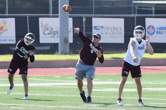 First-year McMurry head coach Jordan Neal throws a pass during the first fall practice in August. The former quarterback coached for four years at Howard Payne before stints at Texas Lutheran and Hendrix.