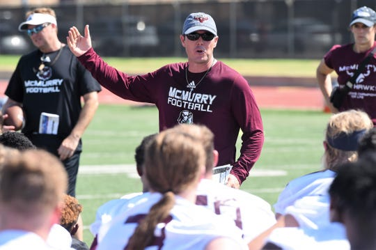 McMurry head coach Jordan Neal talks to his team following the first fall practice at Wilford Moore Stadium on Aug. 15.