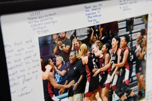 A photograph of Sonita Warren-Dixon, Asheville High's three-time state champion girls basketball coach, with written notes from her team in the athletic director's office.