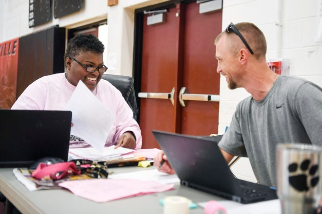 Sonita Warren-Dixon, Asheville High's new athletic director, talks with assistant athletic director Jesse Swain August 12, 2019.