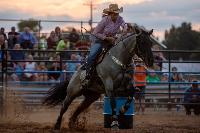 Cowgirls barrel race during a Lost Nations Rodeo on Wednesday, Aug. 14, 2019 at the Calhoun County fairgrounds in Marshall, Mich.