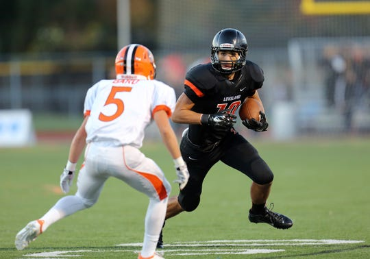 Loveland receiver Giovanni Ricci runs the ball after a catch in the game between the Anderson Redskins and the Loveland Tigers at Loveland High School on October 3, 2014.