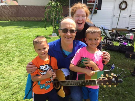"Johnny Only, center, is an Endwell-based toddler music entertainer known for his rendition of ""Baby Shark."""