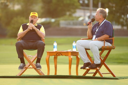 Golf legend Jack Nicklaus speaks with broadcaster Dave Marr III on the 18th green at En-Joie Golf Course on Wednesday night.