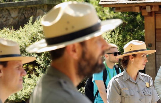National Park Ranger Kelsey Johnson, right, listens as participants of the National Park Service In My Backyard program reflect on their visit to the Bainbridge Island Japanese American Exclusion Memorial on Thursday.