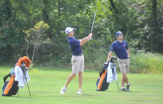 Galion's Spencer Keller watches teammate Matt McMullen approach shot on the 7th hole at Sycamore Creek.