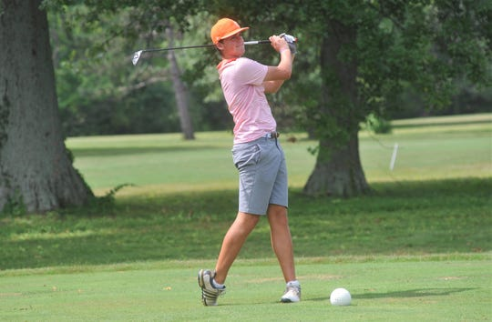 Upper Sandusky's Brett Montgomery tees off on the 9th hole at Sycamore Creek.