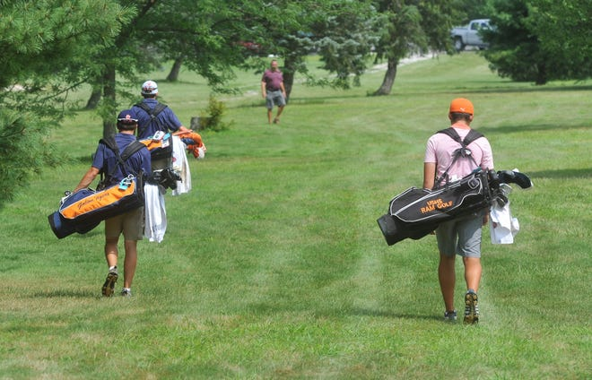 Galion's Matt McMullen and Spencer Keller, along with Upper Sandusky's Brett Montgomery, walk to their balls on the 9th hole at Sycamore Creek.