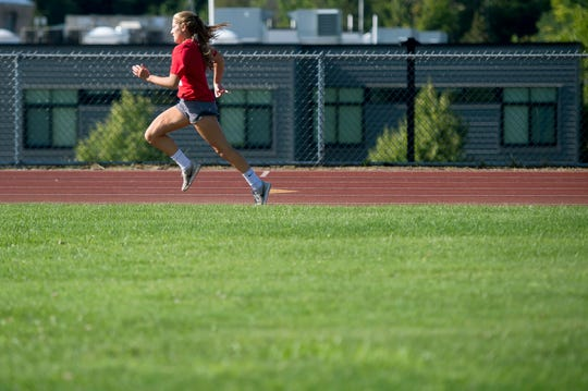 Gillian Magnier races down the home stretch during a fitness test for the Champlain Valley girls soccer team in Hinesburg on Thursday, Aug. 15, 2019.