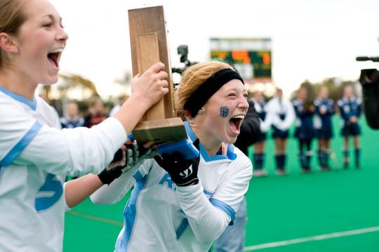 South Burlington field hockey players celebrate after winning their Division I championship game against Hartford at the University of Vermont's Moulton Winder Field in Burlington Saturday, November 6, 2010.