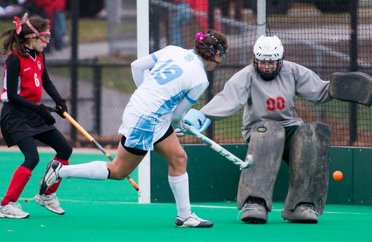 South Burlington High School's Anne-Marie Farmer scores during the Division I field hockey championship game in 2012.