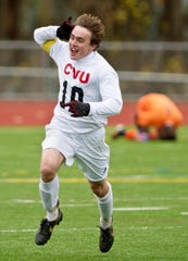 CVU's Shane Haley celebrates his overtime goal against Burlington to win the Division I in 2012.