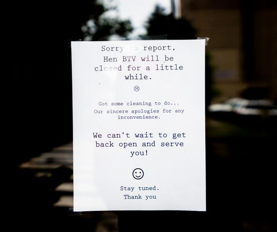 A sign posted on the door of Hen of the Wood in Burlington, saying they will be closed for a bit.