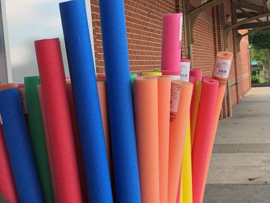 A rainbow of pool noodles is displayed outside a Michael's Store at East Gate Square in Moorestown. People have found creative and practical uses for pool noodles.