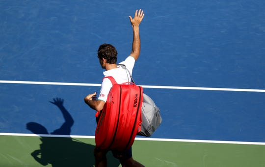 Roger Federer, waves to fans as he leaves Center Court after losing to Andrey Rublev, 3-6, 4-6 during the Western and Southern Open at The Lindner Family Tennis Center in Mason Thursday, August 15, 2019.