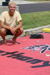Fairfield High School senior Anthony Russo used a stencil to paint the school's Indian head onto his parking space.